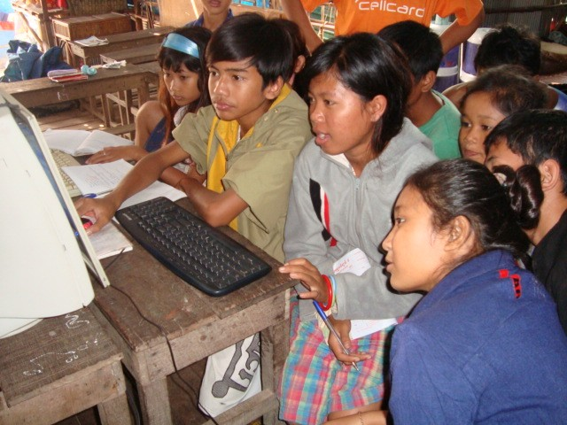 Computer class in orphanage - many students, one computer