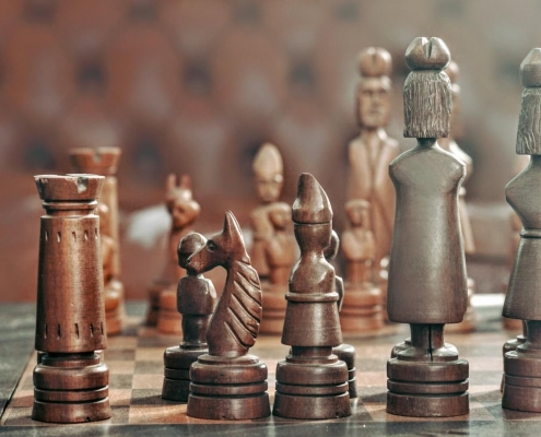 Game of strategy: chess pieces on the table