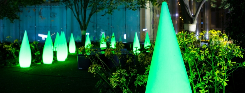 Night garden with plants and green lights