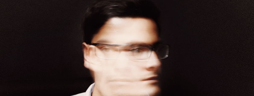 Fuzzy and blurry image of a person having a headache or being of two minds